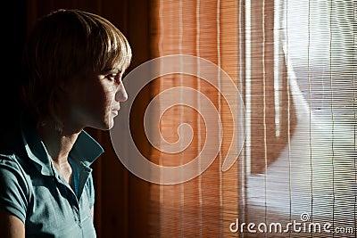 Girl sitting against a window