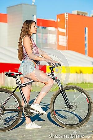 girl sitting bicycle nice park 55349686