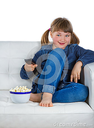 Girl sitting on a couch watching TV