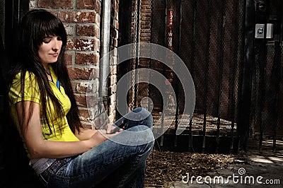 Girl sitting by the door