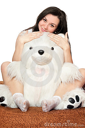 Girl sitting in an embrace with a teddy bear