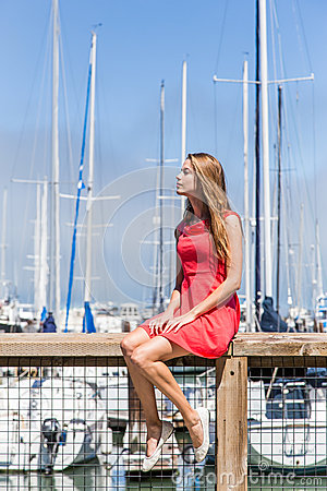 Girl in a yachting marina
