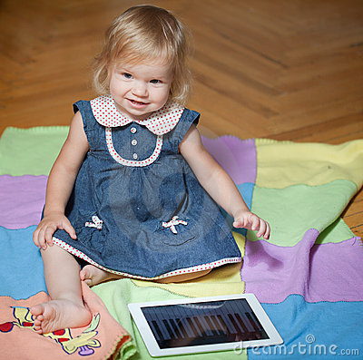 Girl sitting in the floor with tablet computer