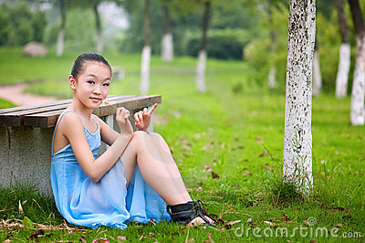 Girl sitting on the grass