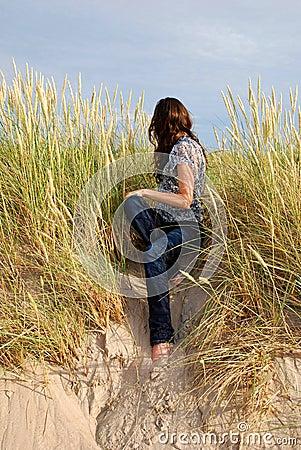 Girl sitting among the grass