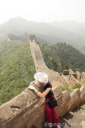 Girl is sitting at The Great Wall of China Editorial Photography