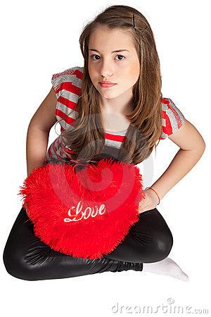 Girl Sitting With Heart Shaped Pillow