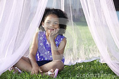 Girl sitting in her canopy
