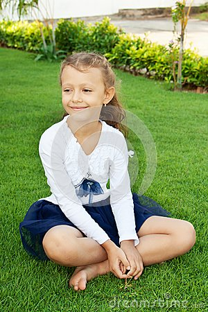Girl sitting on the lawn