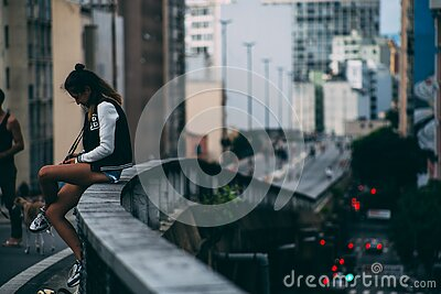 Girl Sitting On Ledge Above A Road Free Public Domain Cc0 Image