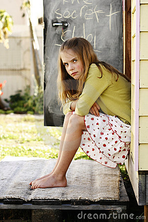 Girl sitting looking angry