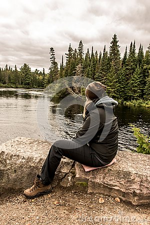 Free Girl Sitting Near Lake Of Two Rivers In Algonquin National Park Canada Ontario Natural Pinetree Landscape Royalty Free Stock Photo - 104222905