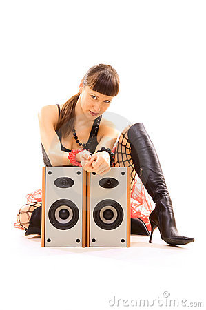 Girl sitting near speakers and staring