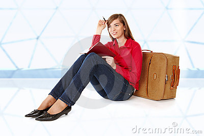 Girl sitting near a suitcase