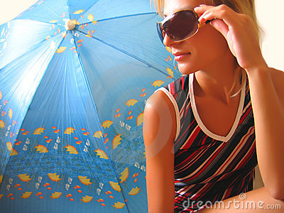 Girl sitting near an umbrella