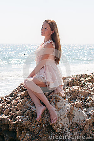 Free Girl Sitting On A Rock Stock Photos - 44649523