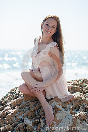 Free Girl Sitting On A Rock Royalty Free Stock Photos - 44649628