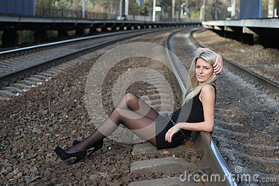 Girl sitting on rail