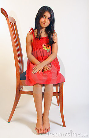 Girl sitting in red dress