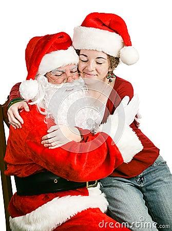 Girl Sitting on Santas Lap Getting a Hug