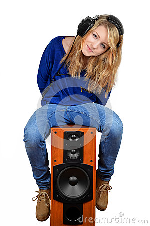 The girl sitting on the speaker