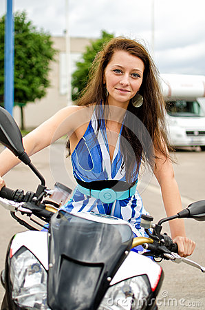 Girl sitting on a sports bike