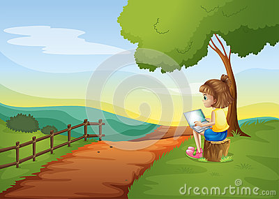 A girl sitting at the stump while using the laptop