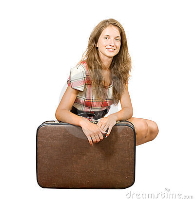 Girl sitting with suitcase