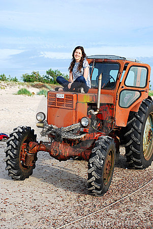 Girl sitting on the tractor