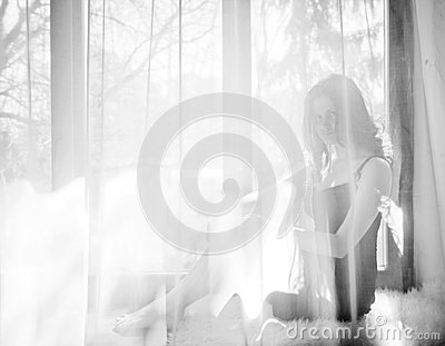 Girl sitting on windowsill