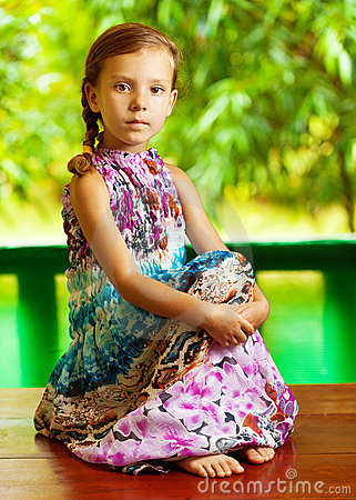 Girl sitting on wooden table