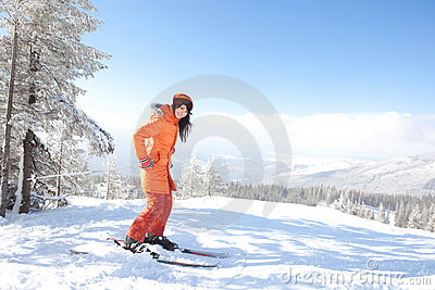 Girl with ski in the winter landscape