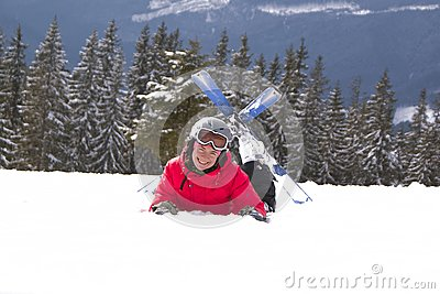 Girl skier lie on the snow