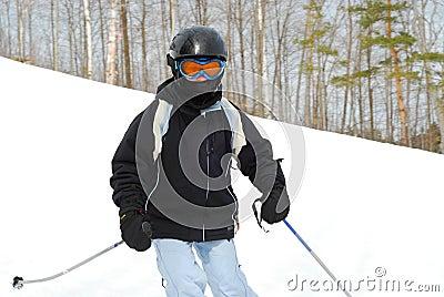 Girl skiing downhill