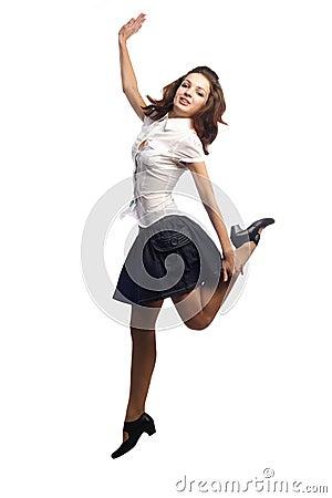 Girl in skirt jumping one leg  isolated white
