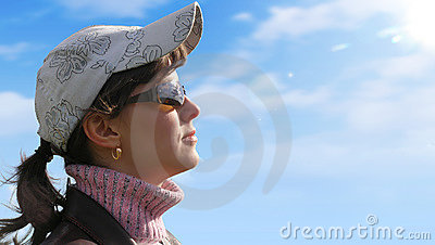 Girl on a sky background