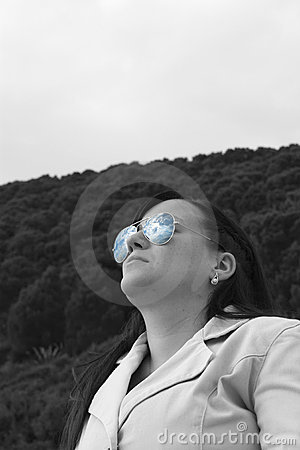 Girl with the sky in sunglasses