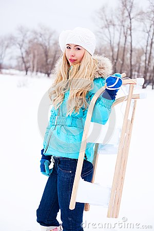 Girl with a sled