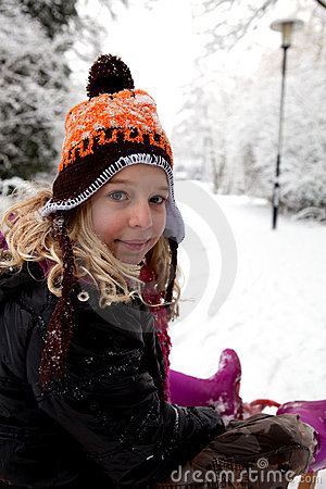 Girl on sled in the snow