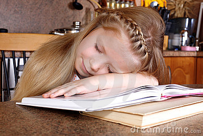 Girl sleep at books