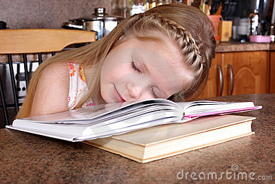 Girl sleep at books