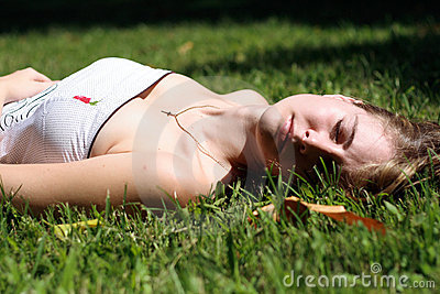Girl sleep on grass