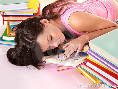 Girl sleep on pile of book.