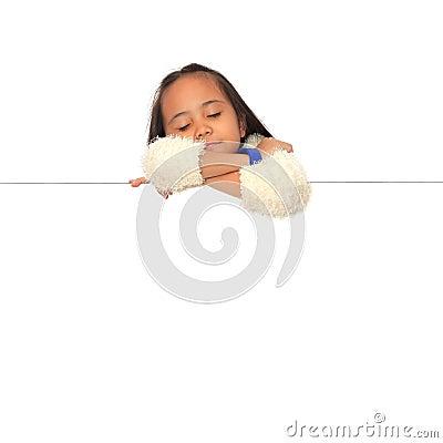 Girl sleeping on blank white board.