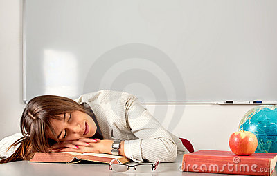 Girl sleeping in classroom