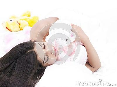 Girl sleeping with her teddy bear