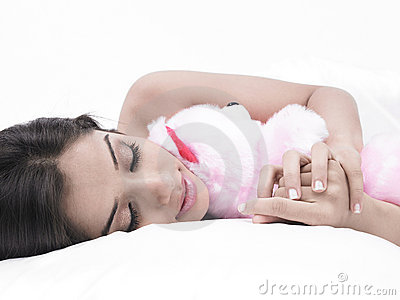Girl sleeping with her teddy bear
