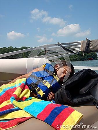 Girl sleeping in life jacket