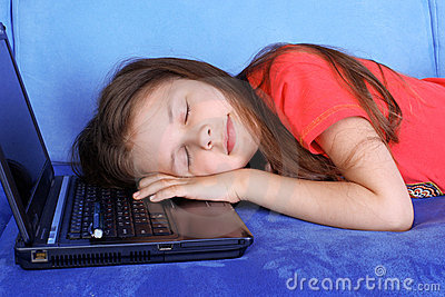 Girl sleeping at the PC