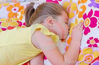 Girl sleeping on pillow
